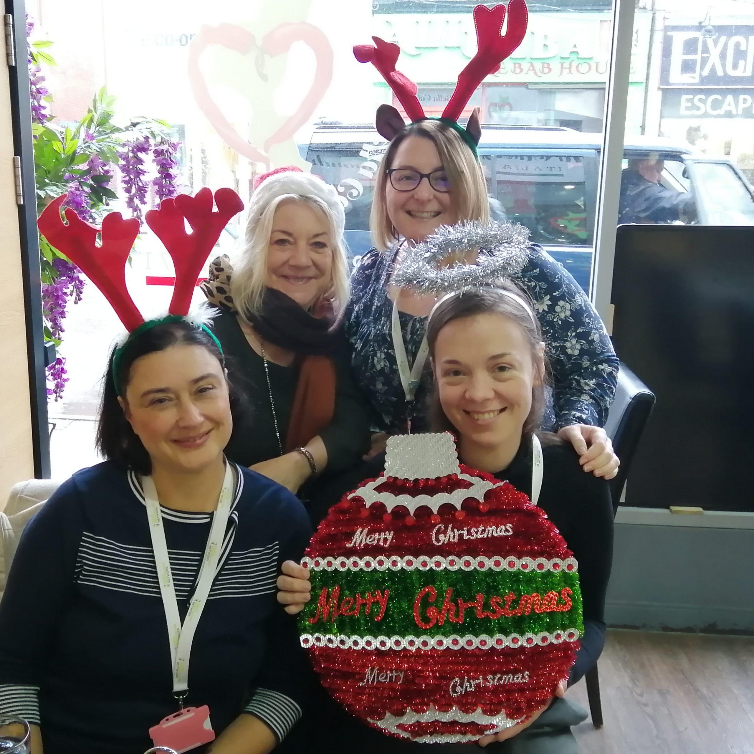 The GNN Team in Christmas headwear